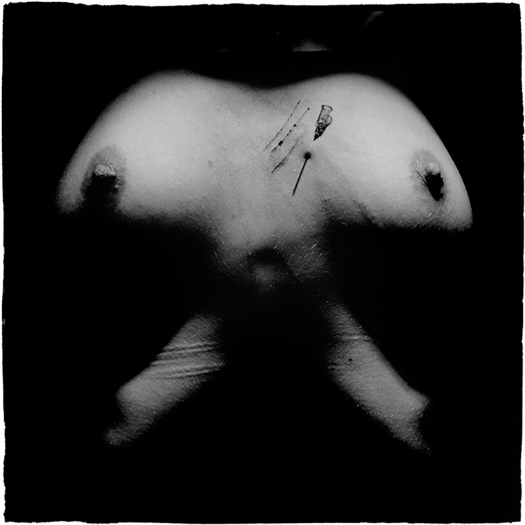 Slovenian photographer Goran Bertok is dealing with human body, pain, pleasure, violence and death. In his series of photographs Stigmata, the female body is exposed to self-harm, visible on the surface of the skin. Skin is a map, scars are paths.